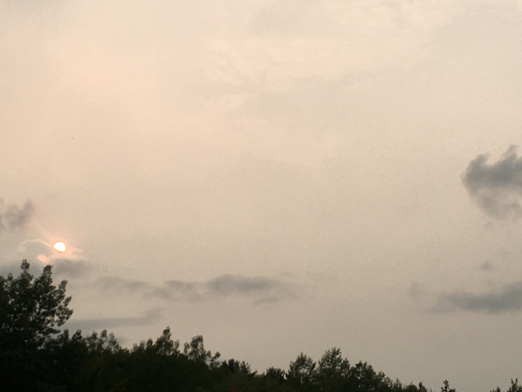 Hazy view of the sun impacted by smoke from wildfires.